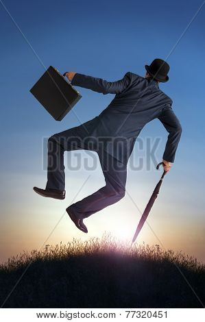 Business Success Concept Businessman Kicking Heels In Air
