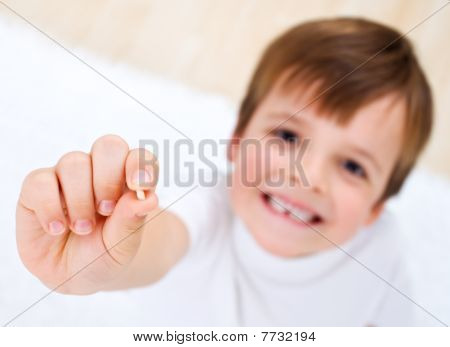 Little Boy Showing His Milk-tooth In His Hand