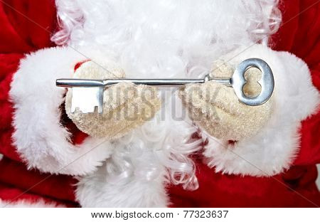 Hands of Christmas  Santa Claus with a key