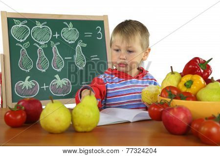 little boy is engaged in mathematics