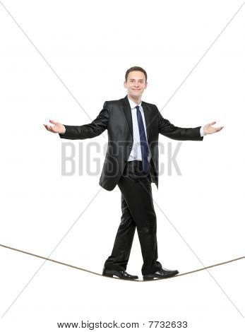 A business man walking on a high tightrope