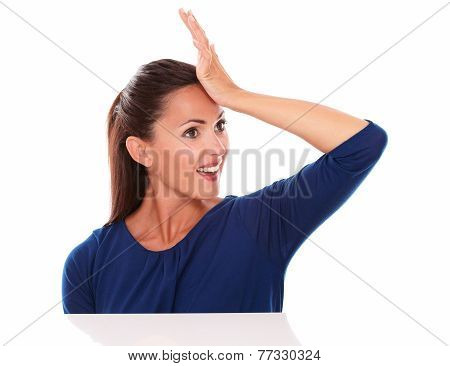Woman With Hand On Forehead Looking Surprised