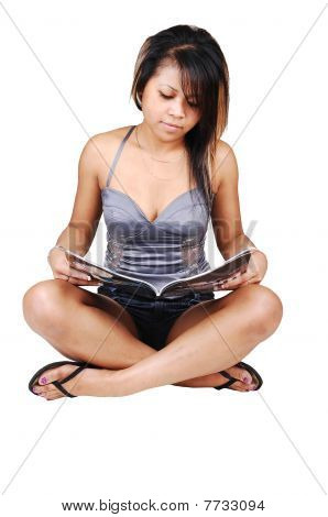 Asian Girl Reading A Magazine.