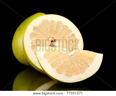 Three Pomelos,half,quarter Isolated On Black