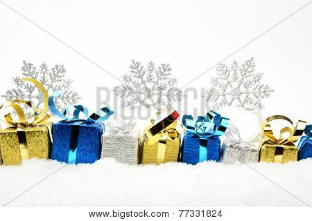 Silver,blue,golden Christmas Gifts With Snowflakes On Snow