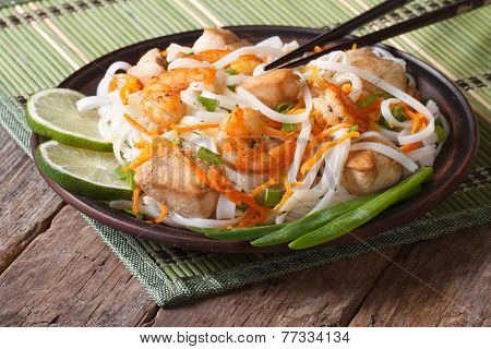 Rice Noodles With Seafood And Chicken Closeup. Horizontal