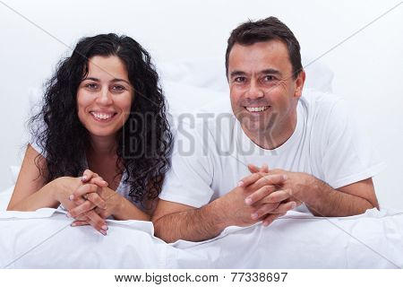 Simply happy couple - smiling young woman and man