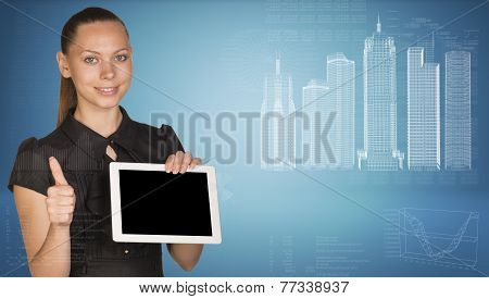 Beautiful businesswoman holding tablet pc. Buildings and figures as backdrop