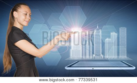 Beautiful businesswoman, tablet pc and spatial layouts of buildings, Hexagons as backdrop.