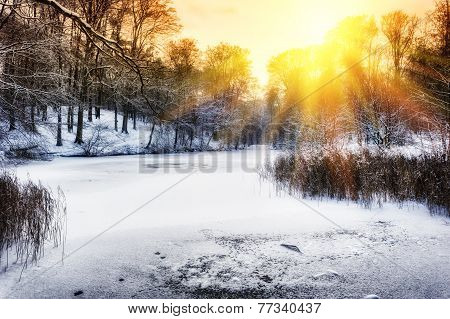 Sunset Over Winter Forest Lake