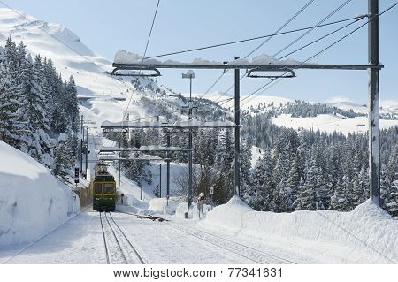 engernalpbahn train approach station in Grindelwald, Switzerland.