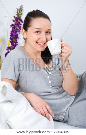 Woman With Cup Of Coffee In The Morning