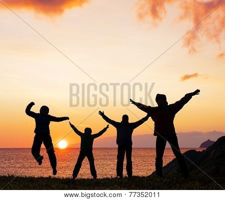 Silhouette of sport  friends on beach