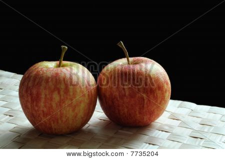 Apples on grass mat