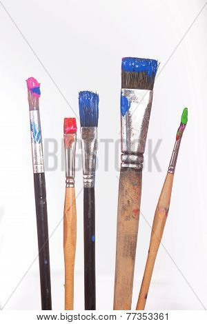 Painting Utensils In Front Of Colored Pallet