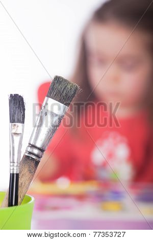 Painting Utensils With Girl In The Background
