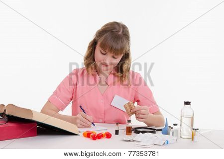 Pharmacist Rewrites Name Tablets To Notebook