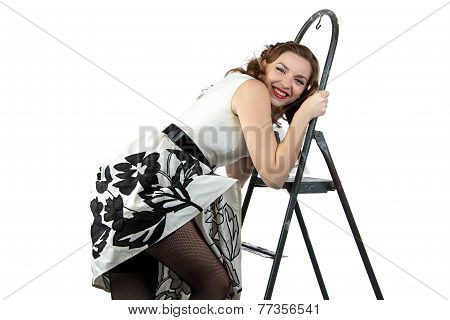 Image smiling pin up woman down the stairs