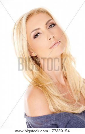 Close up Gorgeous Woman with Long Blond Hair Wearing Gray Off Shoulder Clothing  Looking at the Camera. Isolated on White Background.