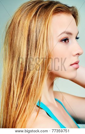 Pretty girl teenager with long hair and beautiful smile expressing happiness. Hair care, healthy hair. Healthy teeth.