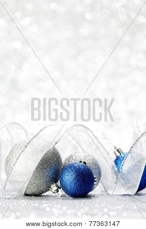 Silver and blue decorative christmas balls on bokeh background