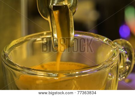 Golden Espresso Flowing Through Single Portafilter Into The Cup