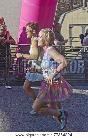 Man And Woman Race In The Color Run