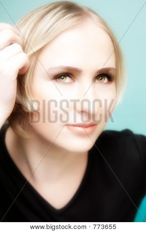 Thinking Young Blond Woman With Green Eyes