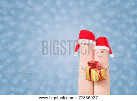 Fingers Faces In Santa Hats With Gift Box. Happy Couple Celebrating Concept For Christmas
