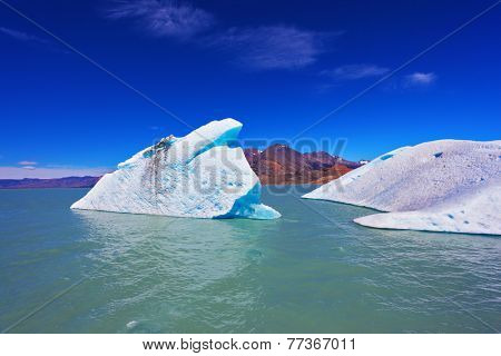 Huge white and blue icebergs floating in the icy water of emerald lake in Argentina. Unique lake Viedma in arid Patagonia