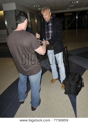 Los Angeles - February 6 : Actor Kevin Costner Is Seen Signing A