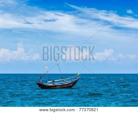 Old fishing boat in sea. Mui Ne, Vietnam