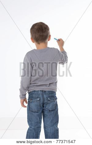 Kid Thinking With Chalk In Hand