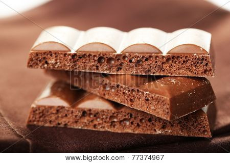 Tasty porous chocolate on table, close up