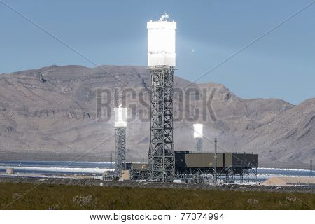 IVANPAH, CALIFORNIA - November 26, 2014:  Focused mirrors producing intense heat shimmers at the massive 392 megawatt Ivanpah solar power plant in California's Mojave desert.