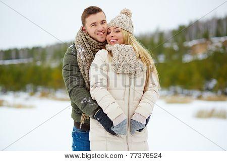 Amorous dates enjoying winter day in park
