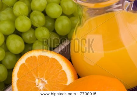 Orange juice with grapes in a carafe