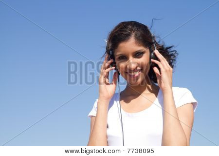 happy young woman with earphones