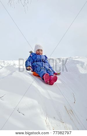 Little Girl Rolling On A Hill