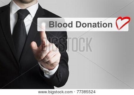 Businessman Pushing Button Blood Donation