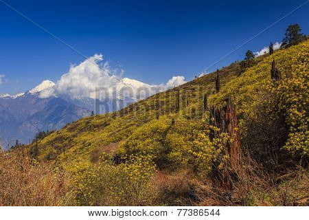 The Slope On A Background Of Distant High Mountains