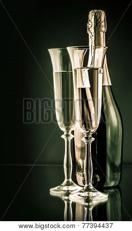 Bottle Of Champagne With Two Full Glasses