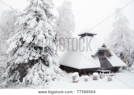 Hut in the winter forest.