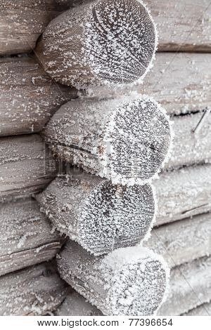 The wall of the hut, covered with frost.