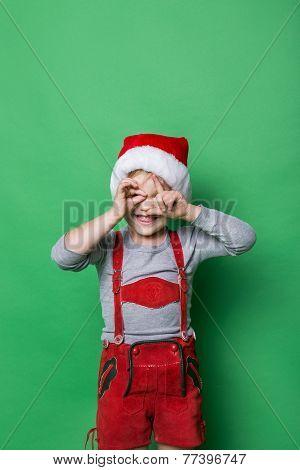 Naughty kid dressed like christmas elf