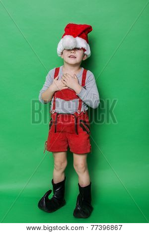 Little beautiful boy with Christmas gnome costume