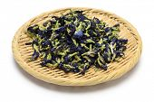 stock photo of nasi  - dried butterfly pea flowers on bamboo basket - JPG