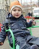 stock photo of funfair  - Child on chain swing on merry - JPG
