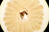 foto of pomelo  - Half of pomelo chinese grapefruit isolated on black background - JPG