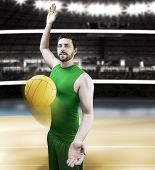 image of volleyball  - Volleyball player on green uniform on volleyball court - JPG